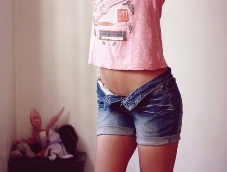 Girl wearing denim shorts and a tee