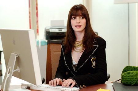 Andie in the office in the movie The Devil Wears Prada