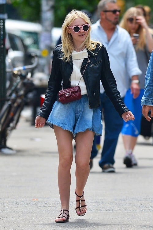 Dakota Fanning denim shorts and white blouse