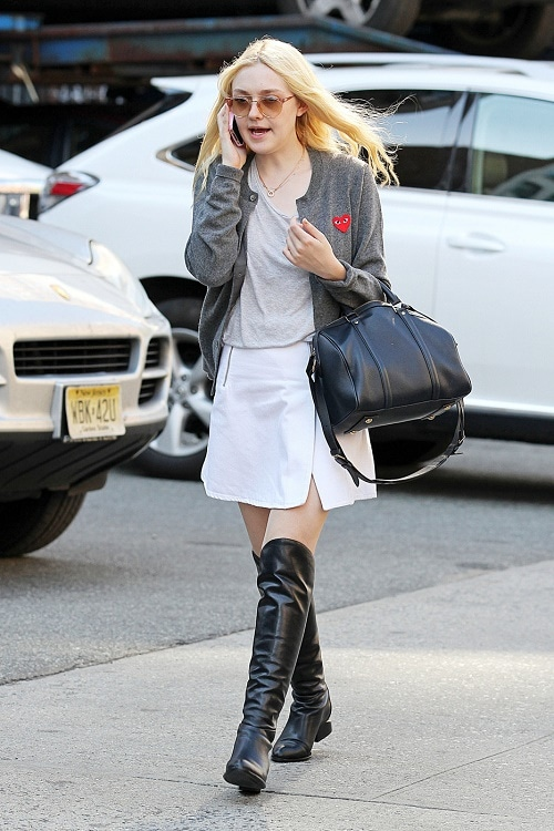 Dakota Fanning white skirt, knee high boots, gray cardigan