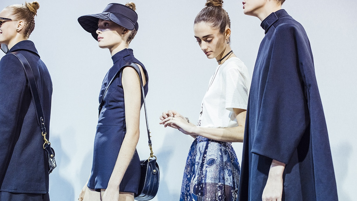 Christian Dior Spring 2017 photo: Models wearing navy blue outfits and hats