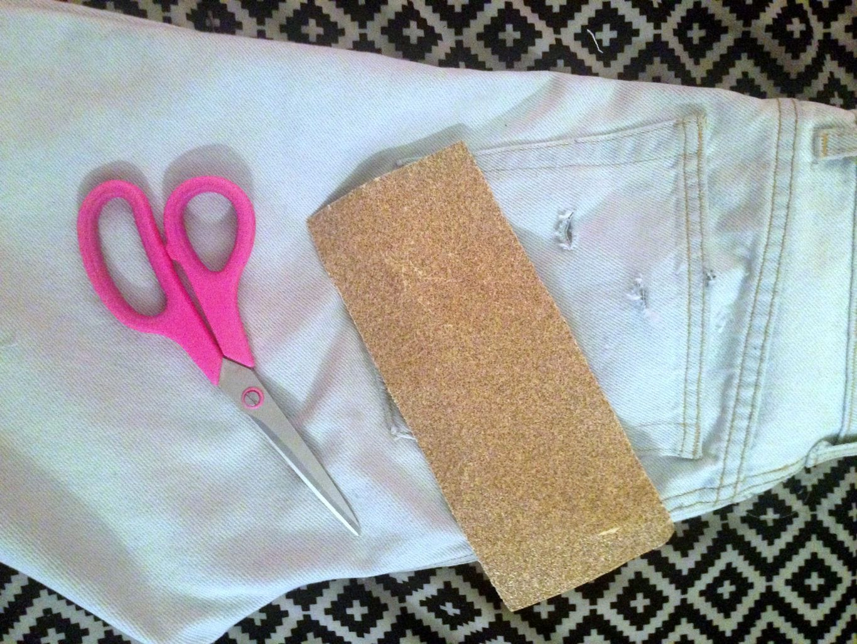 DIY distressed jeans sandpaper