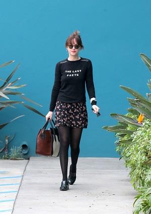 Dakota Johnson sweater and skirt outfit