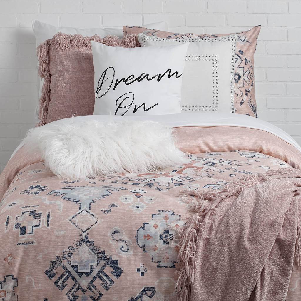 Dormify's pink and blue patterned daydreamer collection dorm bedding.
