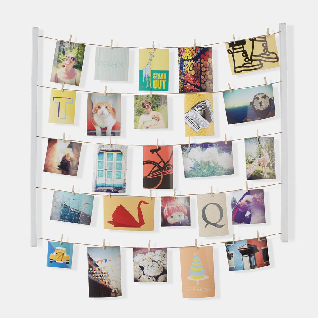 Dormify hanging photo display with wooden clips.