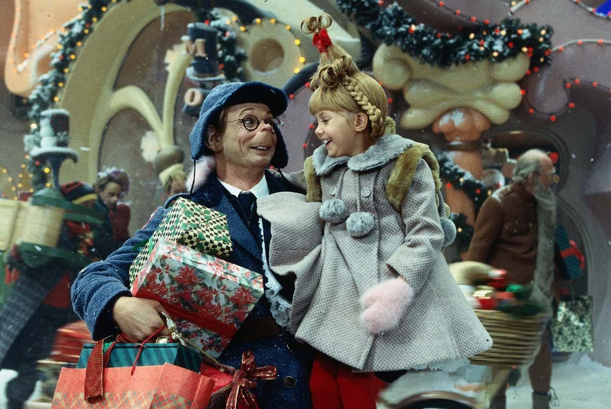 How the Grinch Stole Christmas movie screenshot of the mailman and his daughter Cindy Lou Who
