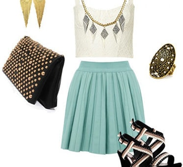Style a bustier and skirt for a night out with an embellished clutch, wedges, statement earrings and cocktail ring