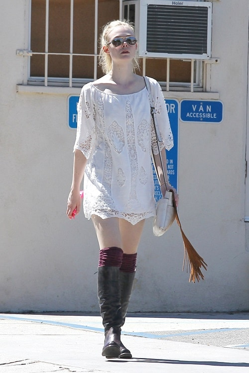 Elle Fanning lace dress and riding boots