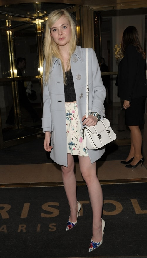 Elle Fanning floral skirt and gray coat