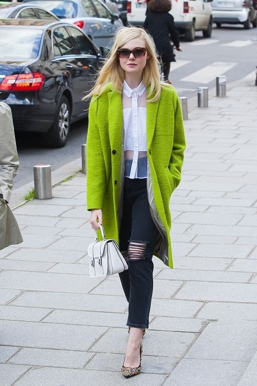 Elle Fanning lime coat, ripped jeans, sheer blouse