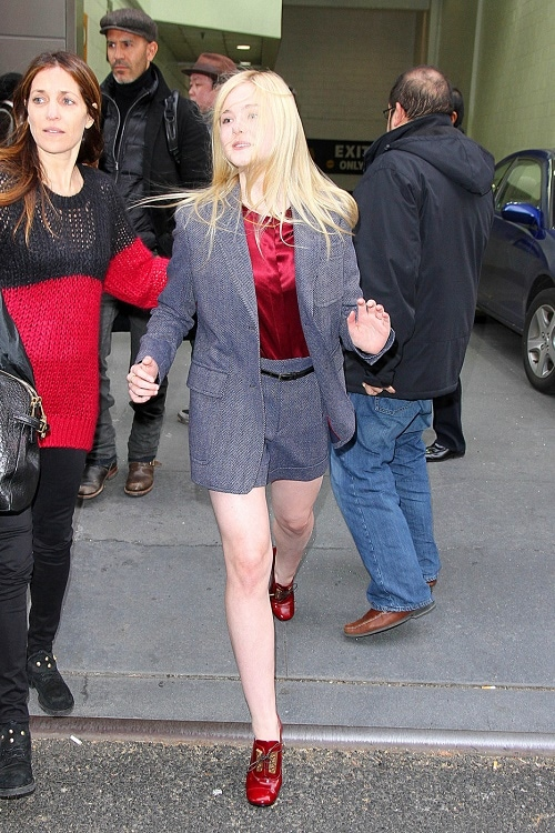 Elle Fanning shorts suit and red blouse