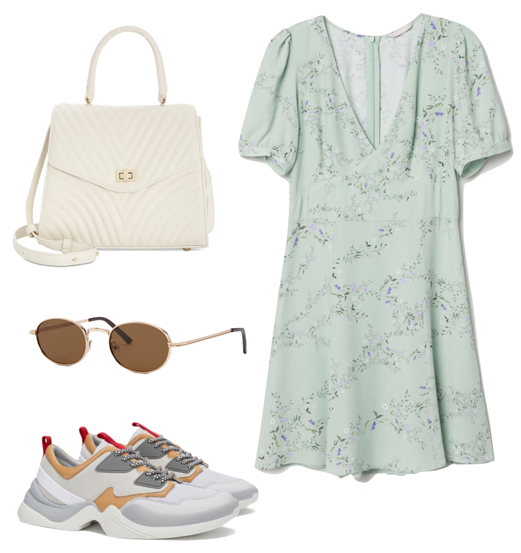 Elsa Hosk Outfit: green floral print puff sleeve mini dress, white quilted handbag, round metal frame sunglasses, and multicolor sneakers
