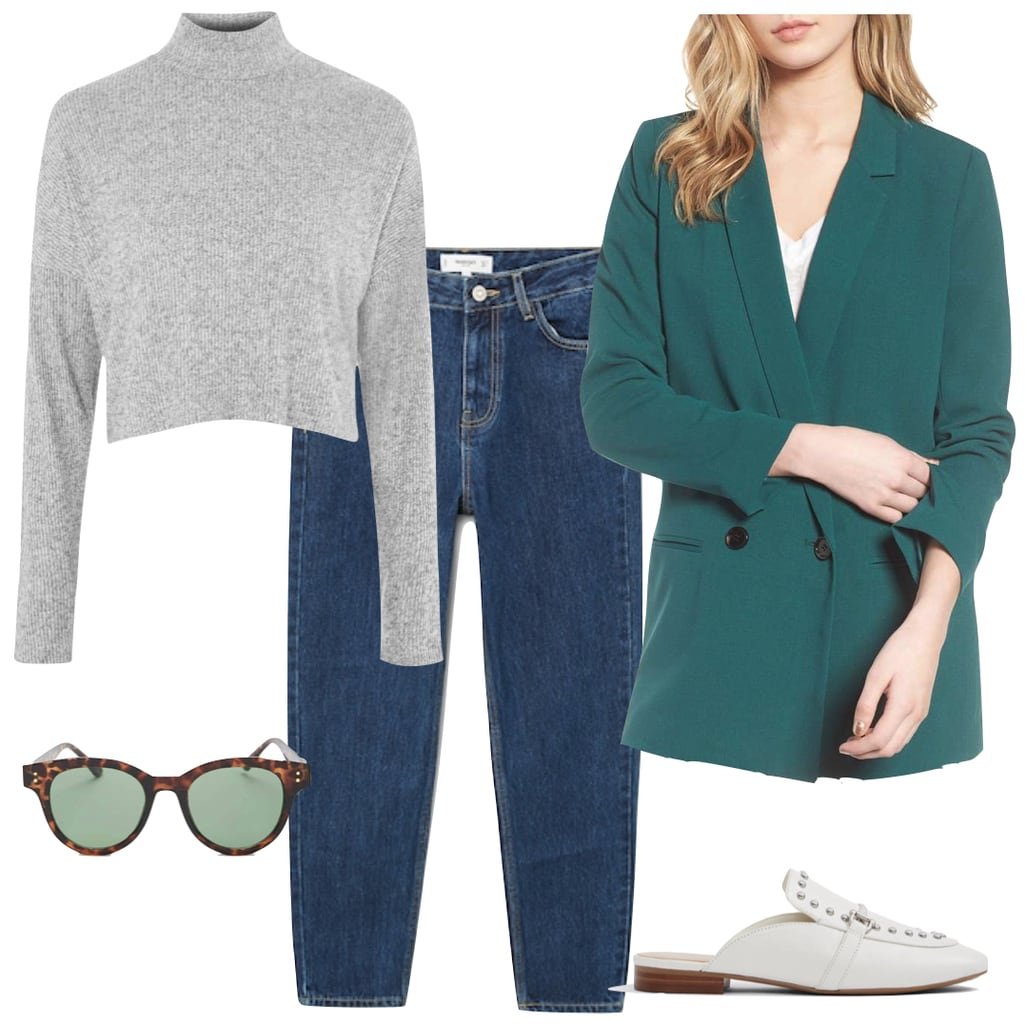 Emilia Clarke Outfit: gray mock neck top, green oversized double-breasted blazer, dark wash straight leg jeans, white loafer mules, and round tortoise sunglasses