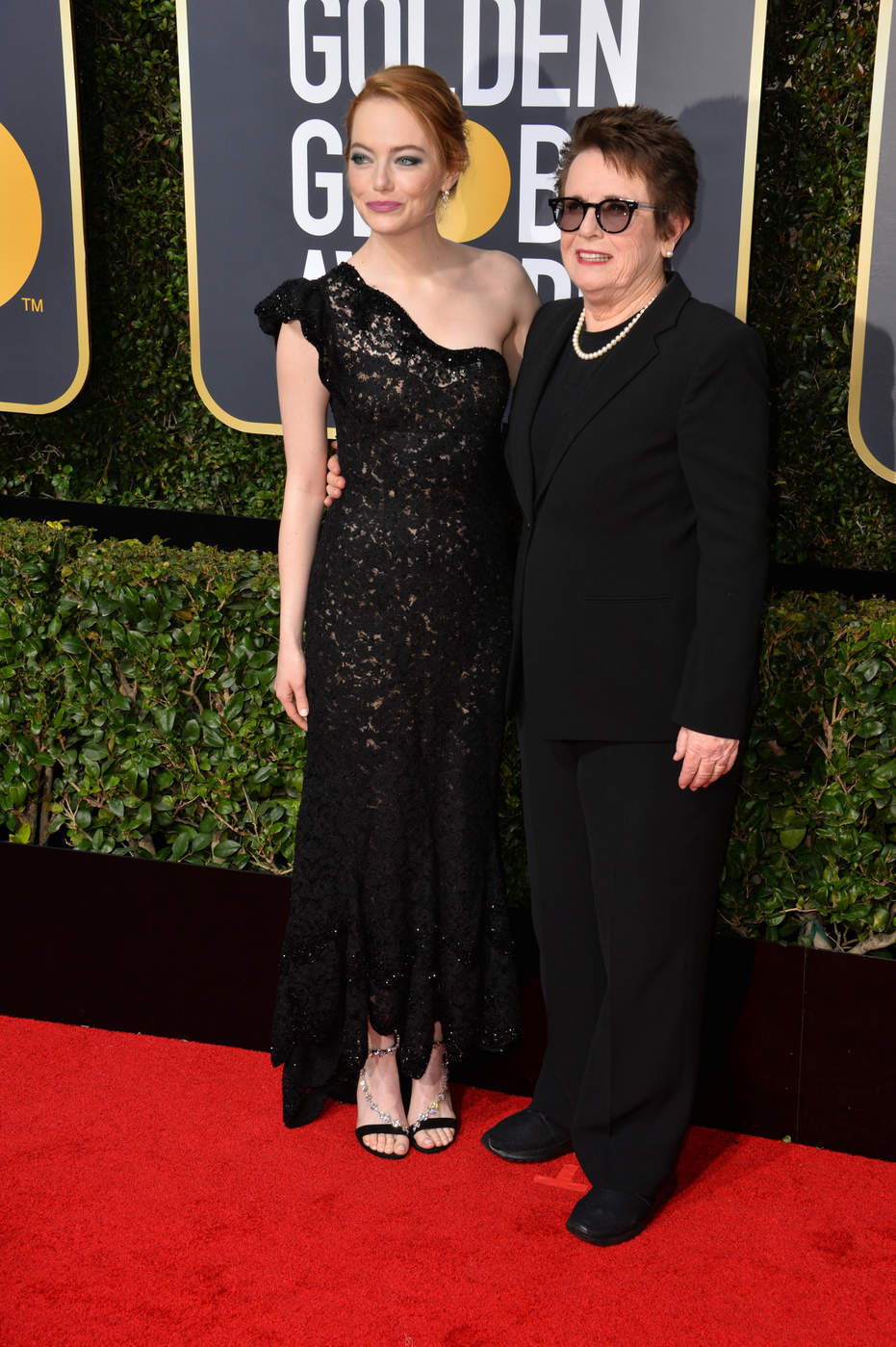 Emma Stone in a black Louis Vuitton one shoulder gown at the 2018 Golden Globe Awards red carpet