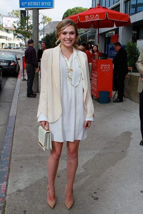 Elizabeth Olsen white shirtdress and cream blazer