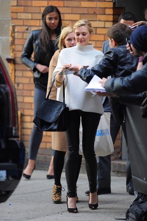 Elizabeth Olsen white turtleneck and leather skinnies
