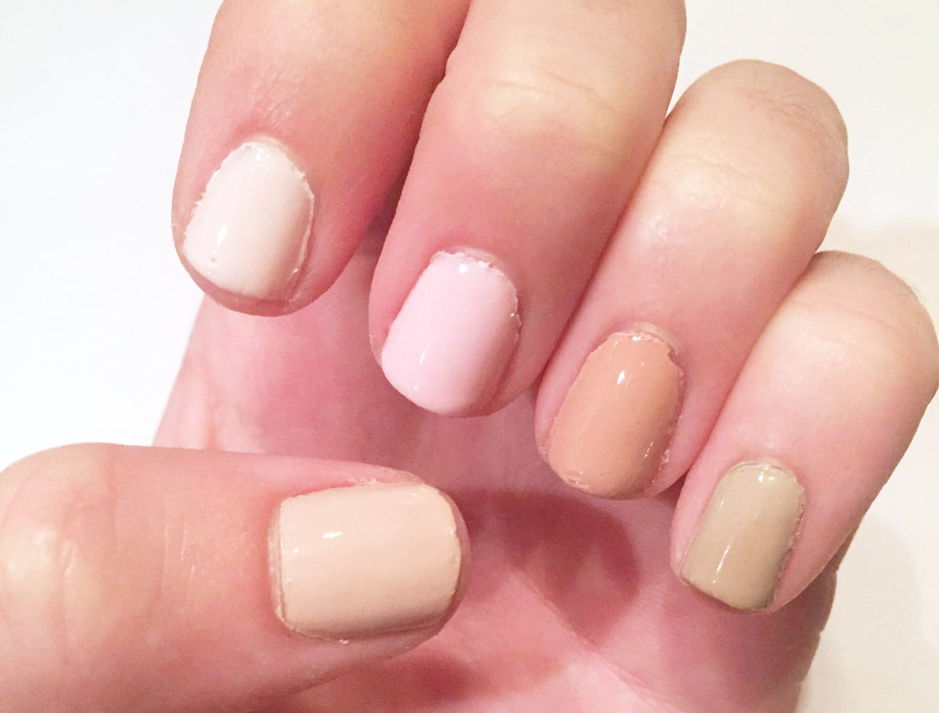 Essie Wild Nudes: Topless and Barefoot on thumb, with Sand Tropez, Bare with Me, Minimalist, and Ballet Slippers on fingers