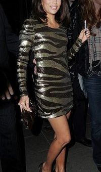 Eva Longoria wearing a tiger print dress