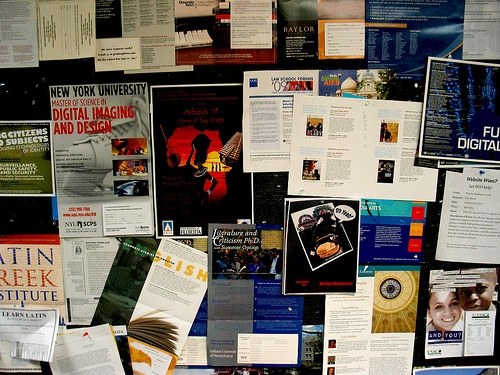 Activity fliers on a college bulletin board