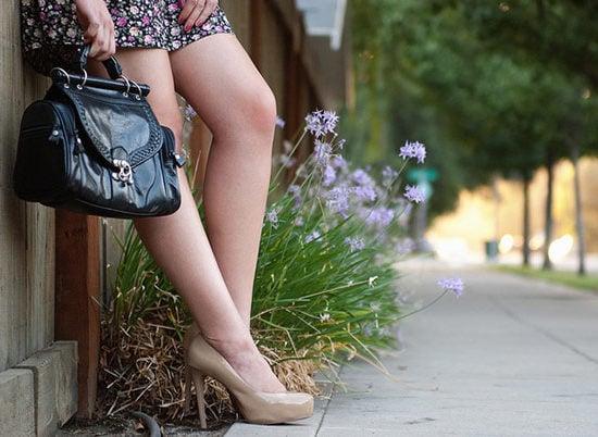 Girl holding a handbag