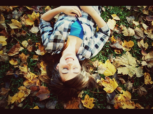 Girl in the fall leaves