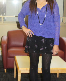 Fashion at American University - student fashionista wearing a purple top, black floral skirt, tights, boots, and accessories