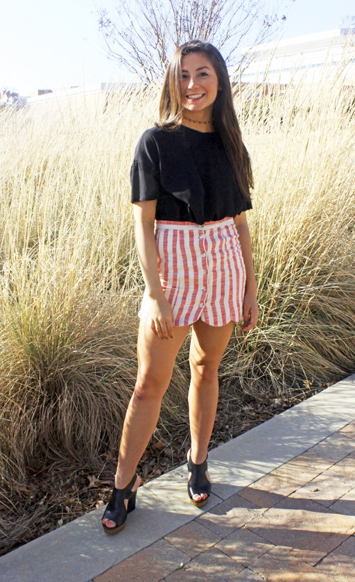 Fashion on campus at the University of Texas at Arlington. Brittany wears a striped scalloped mini skirt, a baggy black tee, a cute choker and black wedges.
