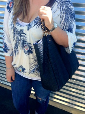 Feather print top and navy blue tote