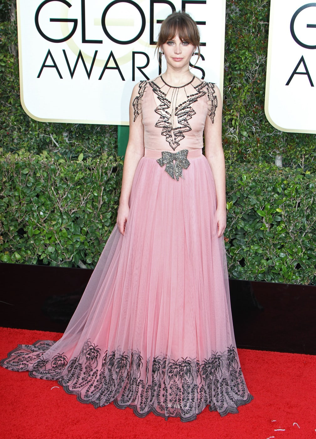 Felicity Jones in a pink Gucci gown on the 2017 Golden Globes red carpet