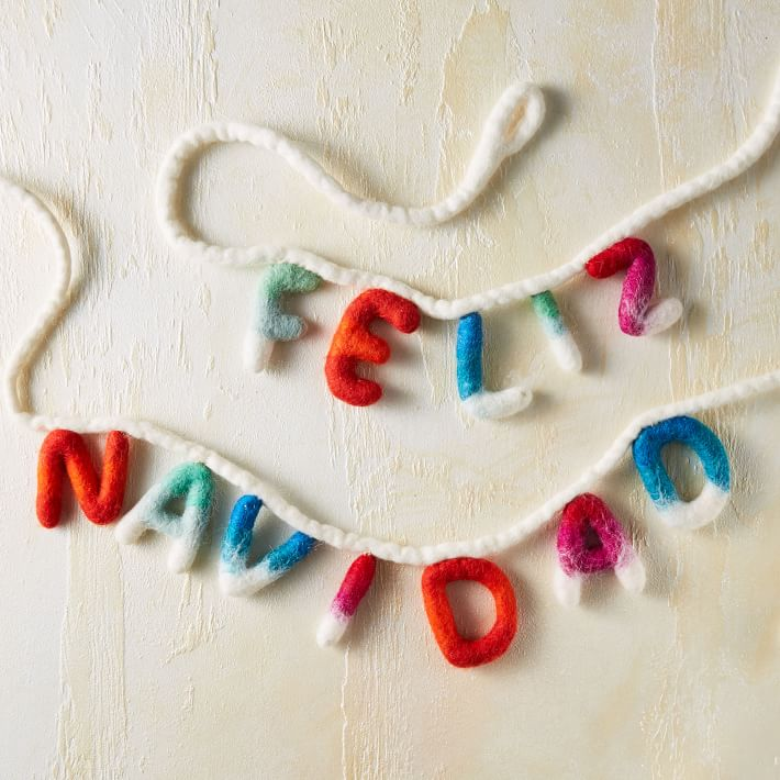 holiday decor garland that reads feliz navidad