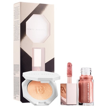 "Fenty Beauty By Rihanna Bomb Baby Mini Lip and Face Set featuring mini-size Killawatt Freestyle Highlighter in ""Hu$tla Baby,"" a shimmery peachy-champagne shade, and mini-size Gloss Bomb lip gloss in ""Fenty Glow,"" a shimmery brownish-pink shade"