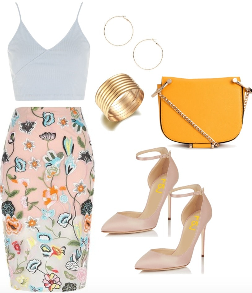 Embroidered skirt outfit: Fierce & flirty embroidered midi skirt in pink with a pale blue crop top, pink pointed toe pumps, orange chain strap bag, gold bangles and gold earrings