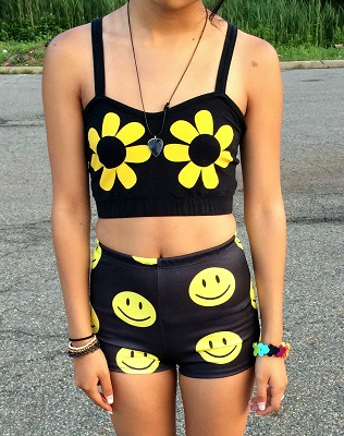 FIT student wearing a flower crop top and smiley face shorts
