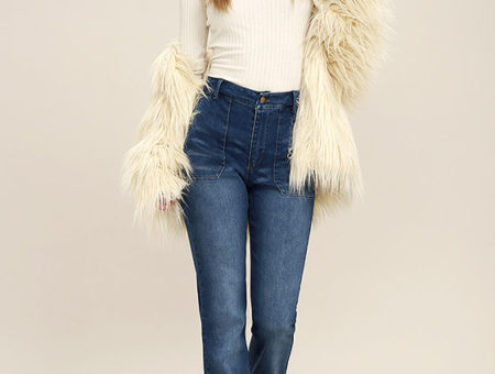 1970s flare jeans with a fur coat