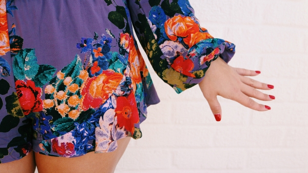 floral romper and red nails