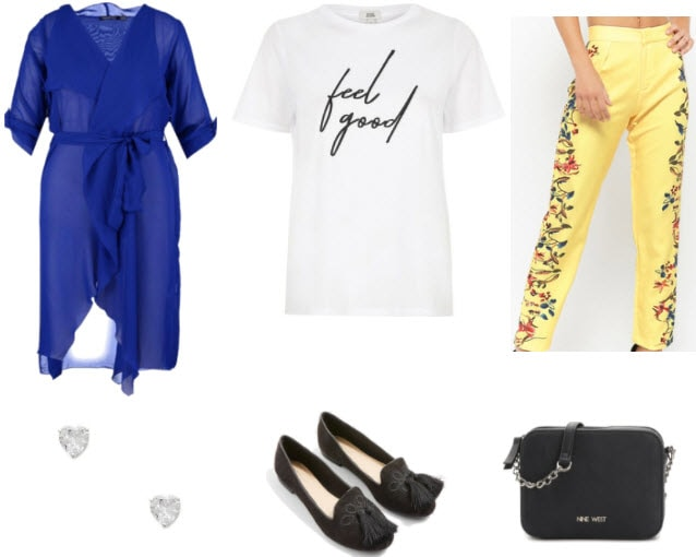 Yellow floral pants with white slogan shirt, sheer blue duster, silver heart earrings, black tassel flats, and black purse.