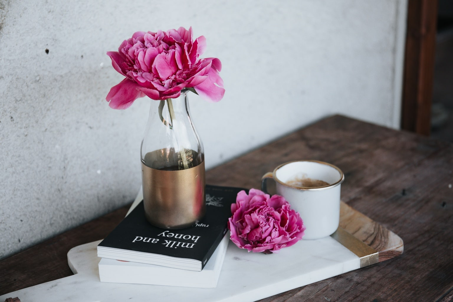 Flowers in a vase with books