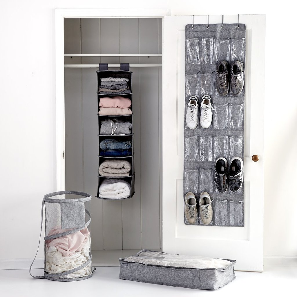 Four piece multiuse closet organizing system with shoe hanging, a vertical hanger for folded clothes, a clothing basket, and a canvas underbed organizer.