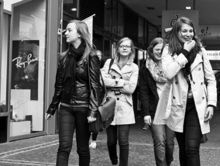 Friends walking down street