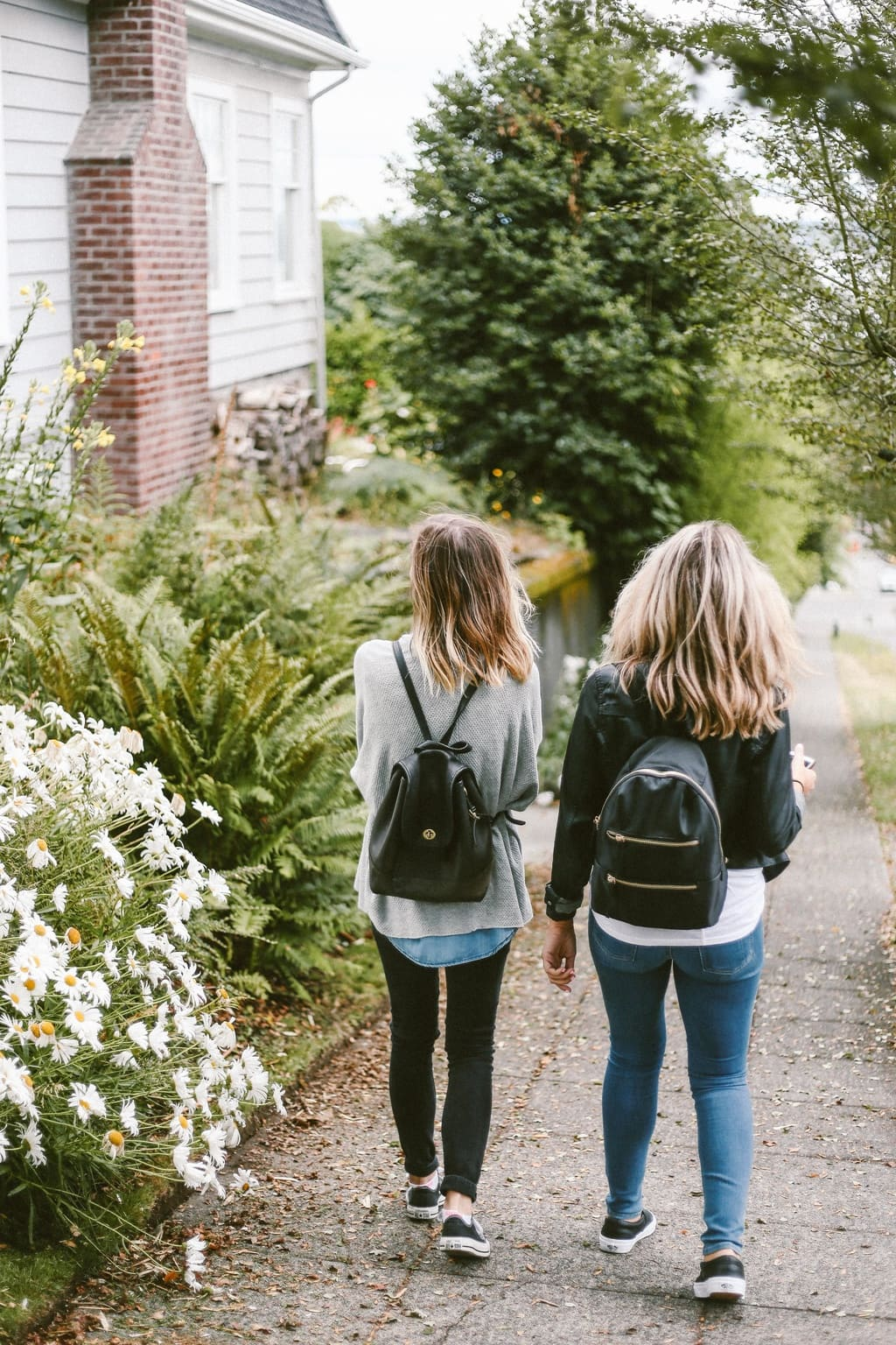 Two female friends going for a walk together