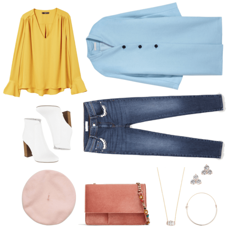 Mustard-yellow long-sleeved v-neck blouse with asymmetric hem and sleeves that flare out slightly at the end, white ankle boots with wooden stack-heel, pale pink beret, baby blue collarless coat with three black buttons, medium-wash skinny jeans with pearl and chain detail at front pockets, velvet salmon-pink bag with gold chain-strap featuring multi-colored jewels and gold flower beads with pearl at center, gold necklace with three baguette clear stones, gold stud earrings with trio of round clear stones, gold wire and chain bracelet