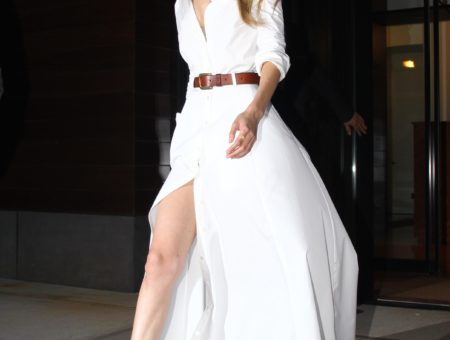 Gigi Hadid, flowing white dress, tan belt and flats.