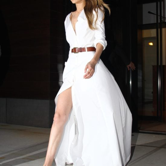 Gigi Hadid, flowing white dress, tan belt and flats.