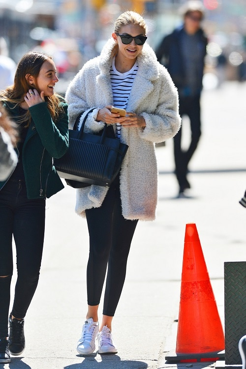 Gigi Hadid fuzzy coat and sneakers