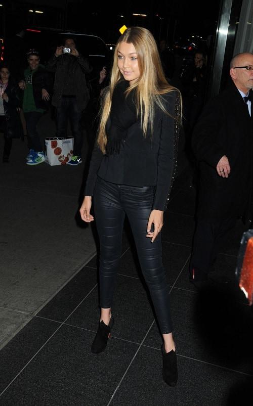 Gigi Hadid leather leggings and suede jacket