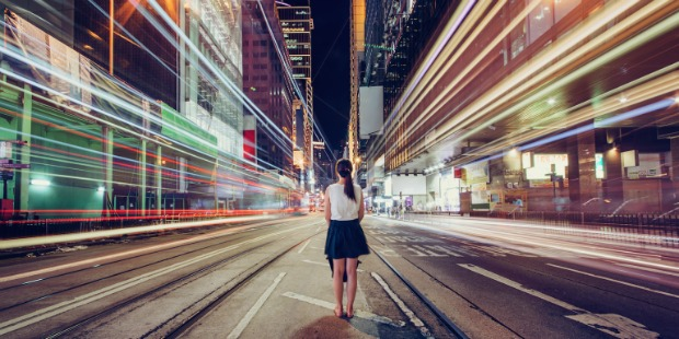 Girl alone in a busy city