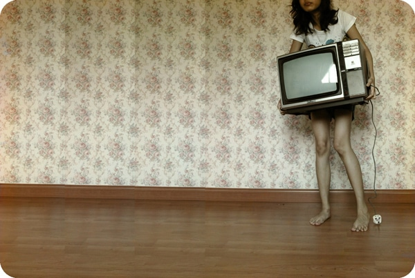 Girl carrying a tv