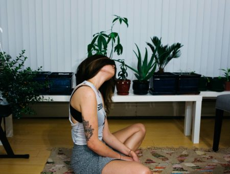 Girl doing yoga in her apartment