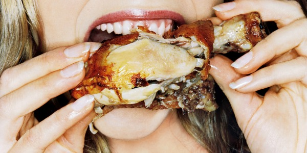 Girl eating wings