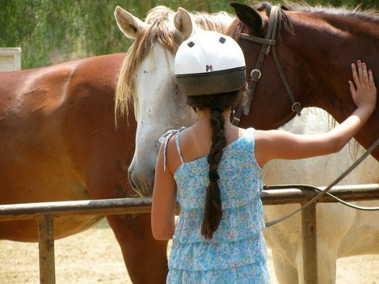 Girl in horseback riding helmet